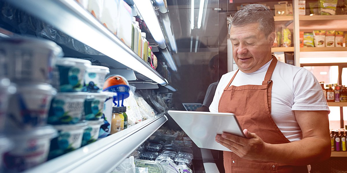 man checking grocery store inventory uipath robot helper