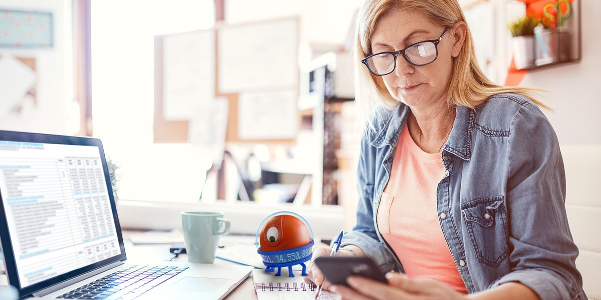 woman working from home uipath robot assistant reviewing work on desk