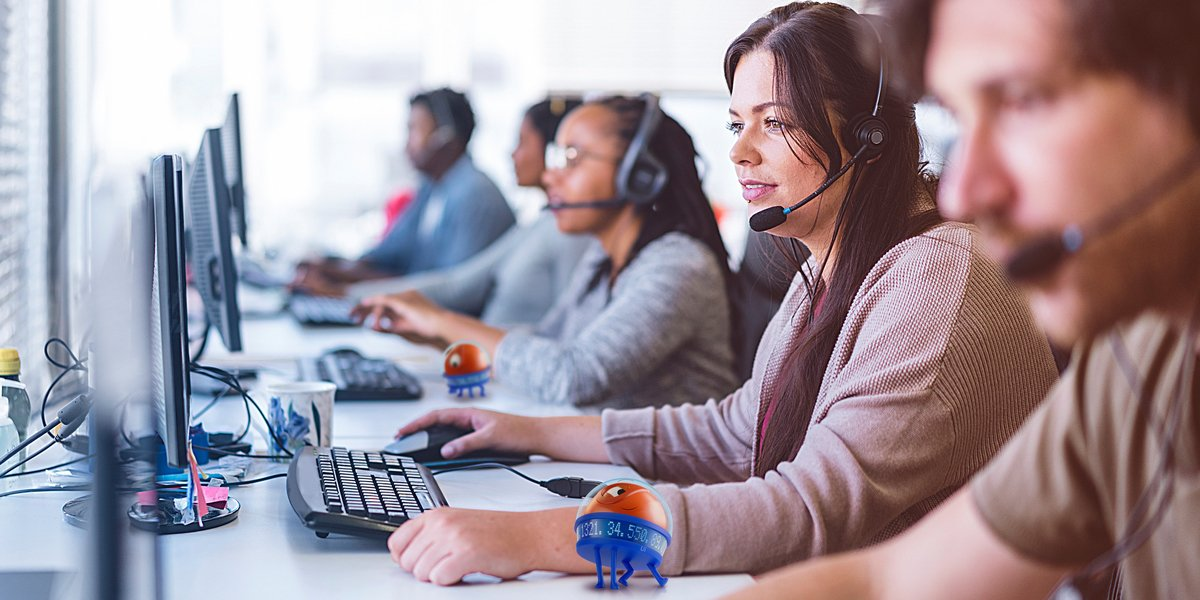 call center operators at desks with uipath robots