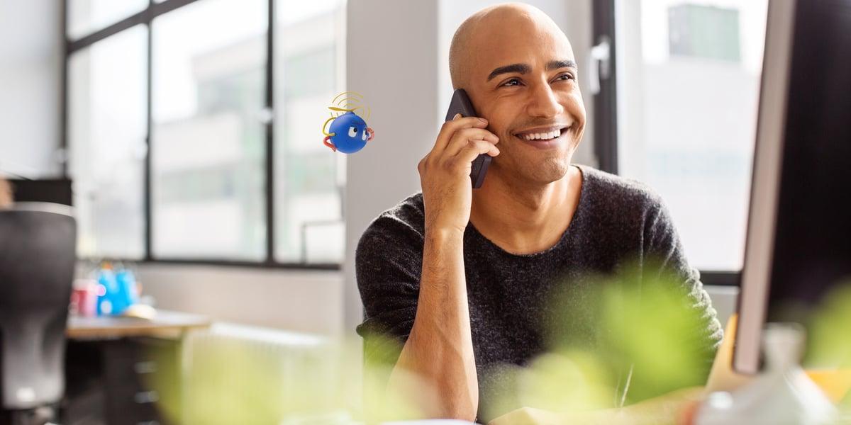 uipath robot assisting man talking on phone at work
