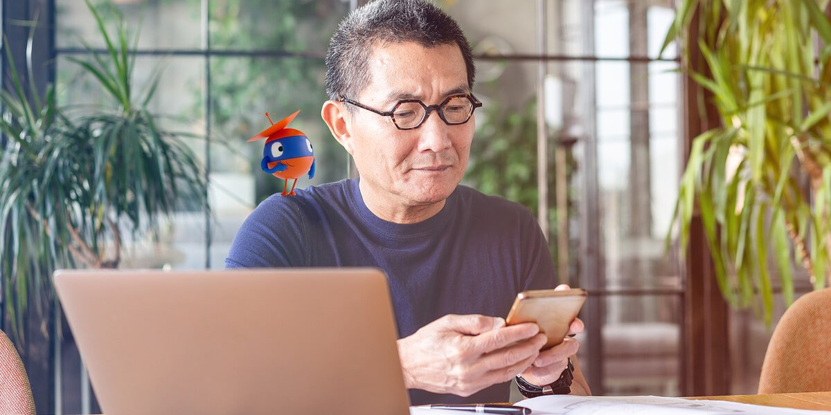 uipath robot helping man on phone and computer